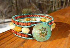 **SALE** Sunshine in Winter - Yellow Calcite and Goldstone 3 Row Cuff | GemOnAWire - Jewelry on ArtFire  One of my customers made this beauty using my hand painted paper bead shank button, love it!