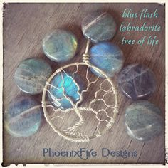 Stunning blue flash labradorite coin beads have an amazing fire and make for an amazing full moon wire wrapped tree of life pendant. Available in your choice of wire colors and handmade by Phoenix Fire Designs on etsy.