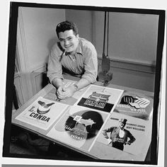 The godfather of record cover art, who died recently at the age of 92, Alex Steinweiss with some of his designs for Columbia records,  photographed by William P. Gottlieb in 1947.  Courtesy of William P. Gottlieb.(Copyright W.P.Gottlieb.)