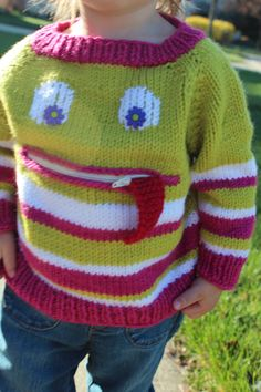 Squeezil, a playful sweater with a tongue that can hide in a zippered pocket by Flora and Fauna Knitwear designs http://florandfauna.wix.com/florandfauna
