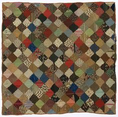 """Log Cabin Quilt and Log Cabin Quilt Top - Cowan's Auctions. 19th c., American. Courthouse steps log cabin quilt in muted red, brown, and green cotton, 62.5"""" x 61.5"""""""
