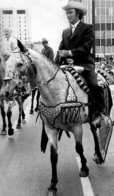Prime Minister Pierre Trudeau rides an appaloosa horse at the Calgary Stampede parade, Calgary, Alberta, Canada, 1971, photograph by Ken Pole.