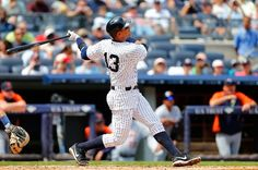 Alex Rodriguez #13 of the New York Yankees follows through on his 2nd inning home run against the Detroit Tigers at Yankee Stadium on August 11, 2013 in the Bronx borough of New York City. (Photo by Jim McIsaac/Getty Images)