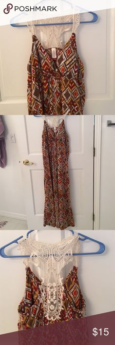 Long maxi dress Long maxi dress with pretty crochet back. Size large. Bust area cups are padded. Worn only once!  Several colors are in this dress...brown, red, white & a gold-yellow color. Dresses Maxi