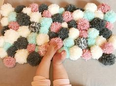 Today, I made a pom pom rug for my rocking chair ottoman in Zoe's room. Super cute & super easy.