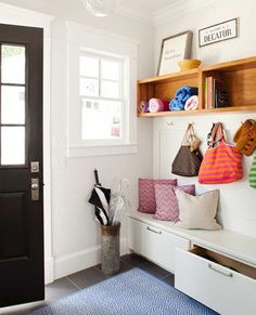 I would love to create a similar storage space in the entryway to our home - hooks on wall where window is - high hooks for adult coats - kid hooks on wall above bench/shoe storage