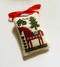 Finished primitive cross stitch ornament by ReginaStitchery