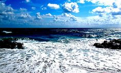 amazing ocean blues mixed with sky and clouds serene with movement of nature.