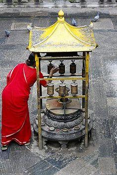 Woman and prayer wheels, Golden Temple, Patan, Nepal, Asia