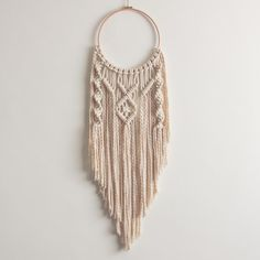 This macrame hoop, dream catcher is handmade using 100% cotton cord in natural ecru with a wooden hoop.  This is a one-off design! Dimension >