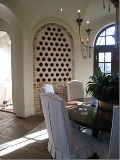 Terra-cotta pipe and plaster wine wall-build in an old basement...