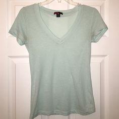 Turquoise v-neck Forever 21 Light blue/ turquoise v-neck. Very lightweight. Forever 21 Tops Tees - Short Sleeve