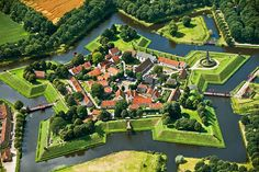 Bourtange, the Netherlands      After serving as a military stronghold from 1593 to 1851, this star-shaped fortress was converted to civilian use—its geometric walls were lowered and its moats filled. In 2002, after a decades-long renovation, the verdant village was unveiled as a living history museum dedicated to the year 1742. The museum is complete with drawbridges, cannons, and a reconstructed stone mill.