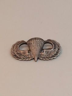 """Sterling Silver Parachutist airborne combat US Army WWII jump wings badge Pin back , Sterling Pinback US Wings  This is not Clutch Lugs, but rare sterling pin back. Hallmark Sterling also has Symbol with R ( Rare ) Measures; 1.50"""" x 0.77""""."""