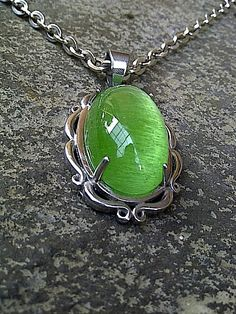Colombia  Emerald, 25mm x 15mm x 10mm with silver necklace