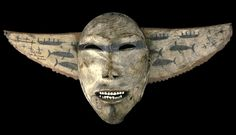 Inupiak ceremonial mask worn in ceremonies of thanksgiving,   with images of whaling crews in skin boats called umiaks.