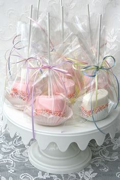 Marshmallow Pops - love the idea to put them on a cupcake liner before wrapping them.  So cute.