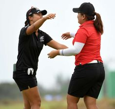 Inbee Park of South Korea, right, gets congratulations from Lydia Ko of New Zealand after winning gold in the final round of women's golf during the Rio 2016 Summer Olympic Games at Olympic Golf Course.    -  Best images from Aug. 20 at the Rio Olympics