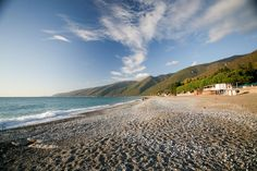 Once upon a time, in a subtropical climate on Georgia's Black Sea coast, there were glorious scenic wonders like beautiful beaches, lush wooded mountains, and buildings of grandeur at a resort para...
