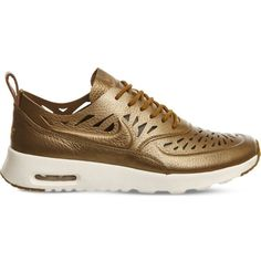 Nike Air Max Thea cutout metallic leather trainers (£88) ❤ liked on Polyvore featuring shoes, sneakers, nike trainers, metallic sneakers, golden sneakers, tan leather shoes and nike shoes