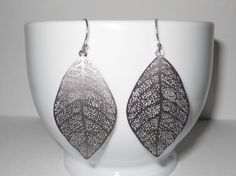Leaf earrings, I love these and have a pair very similar...they are really versatile and work with so many outfits...