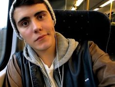 Alfie Deyes, plus he is wearing a beanie... huh. I didnt know that anyone but Hiddles could look good... i was wrong lol