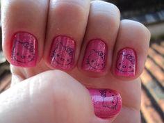 10 Beautiful Hello Kitty Nail Designs - http://slodive.com/inspiration/10-beautiful-hello-kitty-nail-designs/