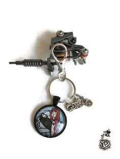 Buy Biker Chick Pin Up Tattoo Art Cameo Key Ring, Girly Biker Gift. Handmade by creative people crafting through DISABILITIES or CHRONIC ILLNESS