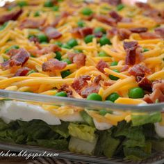 This salad has always been one of my favorites.  Known as a seven layer salad, the number of layers is up to you.  Try chopped spinach leaves mixed in with the romaine if you have some and assemble it with whatever ingredients you want showing on top.