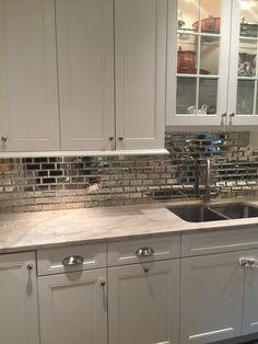 Simply White kitchen cabinet Taj Mahal quartzite mirrored subway tile