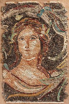Roman mosaic depicting a woman. Ca. 4th century A.D.