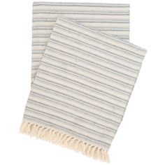 A favorite of designer Annie Selke, this cotton/linen throw is finely woven in soft, blended stripes of taupe, ivory, indigo, and French blue. Pair this fringed throw with shades of blue, neutrals, and textured whites for an easygoing, coastal look.  • 63% cotton/37% linen. • Fringe on 2 ends.