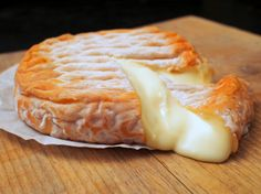 Cutting into a ripe wheel of Epoisses - robust, meaty, delicious.