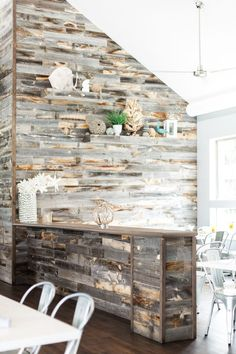 Pin for Later: The Easy Way to Get the Look of Reclaimed Wood For Less  Two shades of wood — one on the wall and one lining the partition — create serious style and depth in this restaurant.