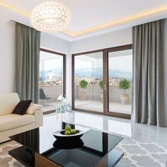 Cream sofa in bright living room interior Big Windows, Windows And Doors, Modern Chandelier, Chandelier Lighting, Color Chrome, Dining Room Lighting, Wood Colors, Living Room Interior, Sliding Doors