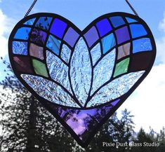Stained Glass Suncatcher, Heart Shaped Lotus Flower Window Hanging, Meditation, Valentine. The lotus flower symbolizes rising from a dark place into beauty and rebirth, as this is exactly how a lotus flower grows. Lotus flowers grow directly out of muddy and murky waters and