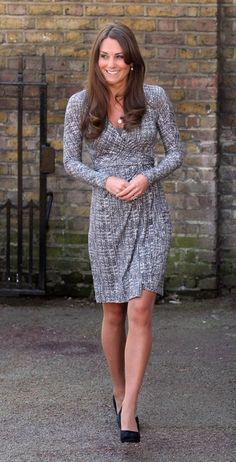 Kate Middleton stuck to her signature maternity fashion style - a pretty, flattering coat. Copyright [PA] | Kate Middleton's pregnancy fashion - Yahoo! omg! UK