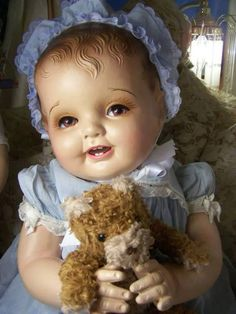 Antique Doll. Beautiful. She does look rather tired - I think it's the eyelashes.