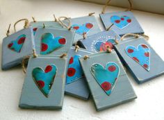 Valentine gifts from Tessella Designs; a variety of plaques made out of recycled wood and tin hearts.