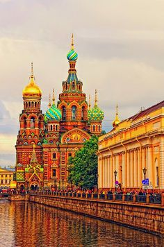 Traverse the streets of St. Petersburg to the vibrantly colorful domed Church of Savior on Spilled Blood, where Emperor Alexander II was assassinated. This famous Russian landmark is situated along the Griboedov Canal, with paved roads on either side.