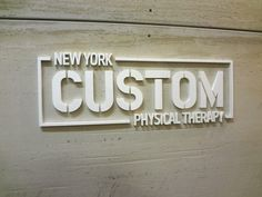 """Cut Acrylic Fabricated Sign NYC - Custom 1/2"""" thick laser cut white acrylic letters pin mounted to unfinished interior wall in NYC. For more information on business fabricated signage, visit http://www.Fabrication.NYC"""