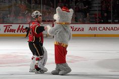 Flames vs. Red Wings, April 17th, Miikka Kiprusoff being congratualted by Harvey the Hound after being named the First Star of the game! Vintage Kiprusoff.