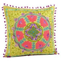 Multicolor throw pillow with a tribal floral motif and pompom trim.   Product: Throw pillow   Construction Material: Ultra suede   Color: Green  Features: Insert included   Hand-crafted  Intimate, comfortable, and warmly hedonistic  Dimensions: 16 x 16    Cleaning and Care: Spot clean