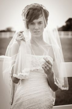 Bridal picture with lace dress and veil.
