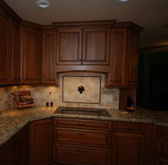 StarMark Cherry cabinets with harvest stain and chocolate glaze, Cambria Bradshaw countertop.