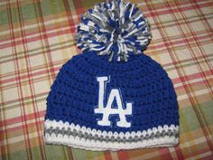 Crochet Beanie Baby Hat (Los Angeles Dodgers) Blue, White and Grey with LA logo and large pom pom on Etsy, $15.00