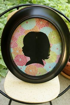 Used to make silhouettes of my students for Groundhog's   Day and then save them as Mother's Day presents for their mom's with a poem attached...love this idea of a similar project...gluing the silhouette on pretty paper and framing...I will definitely be doing this one!