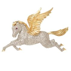 McTeigue Diamond Gold Platinum Pegasus Brooch | From a unique collection of vintage brooches at https://www.1stdibs.com/jewelry/brooches/brooches/