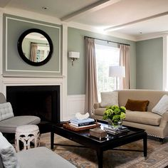 So much appeal in this room comes from the white molding everywhere. I love the thin white frame above the fireplace and the continuation of mantle onto the ceiling. Seems like even faux ceiling beams make rooms look more elegant.