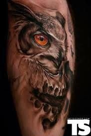 horned owl tattoo, also maybe a skull.